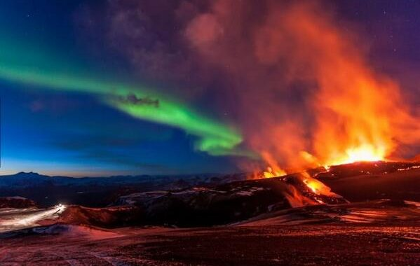 Volcano And Northern Lights In Iceland
