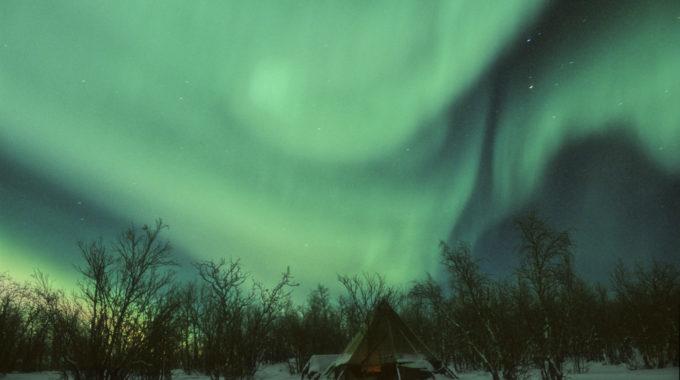 northern lights over teepee