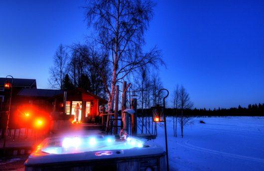 Outdoor hot tub overlooking Frozen Torne river